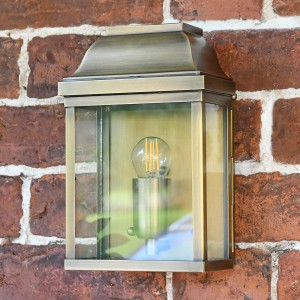 """Heathfield"" Antique Brass Classic Brass Half Wall Lantern in Situ on a Brick Wall"