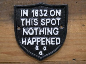 Humorous Emblem Shaped Sign in Black Iron