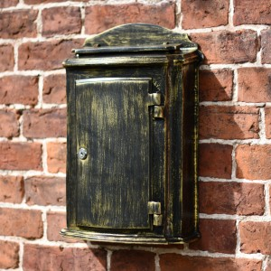 Beautiful Antique classic post box on brick wall