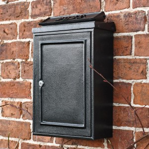 Simplistic Wall mounted post box with brass letters