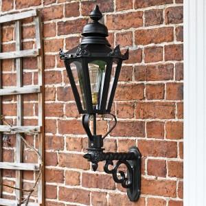 Black traditional porch lantern on brick wall