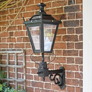 Black Dorchester garden lantern on brick wall