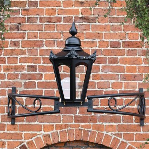 Hexagonal canopy lantern on ornate bow bracket