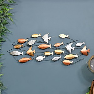 Metallic Swimming Fish Wall Art in Situ on a Blue Wall