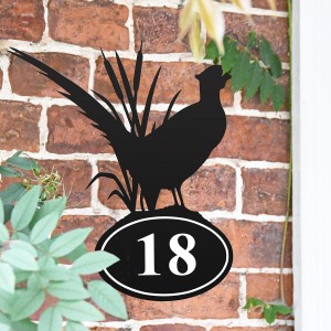 Pheasant Iron House Number Sign in Situ on a Brick Wall