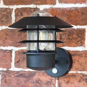 """Skive"" Black Contemporary Wall Light on Situ on a Brick Wall"