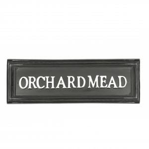 Black rectangular house sign with white letters
