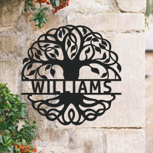 Tree of Life Steel Monogram Steel House Name Sign on situ on a Stone Wall