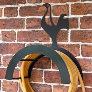 Wall Mounted Contemporary Cockerel Iron Hose Holder Mounted to a Brick Wall