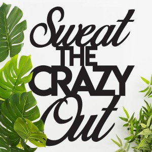 """""""Sweet The Crazy Out"""" Iron Wall Art in Situ Next to Plants"""