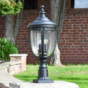 """""""Winsford"""" Black Traditional Countryside Pillar Light in Use on a Driveway"""
