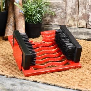 Bright red cast iron three in one boot jack, brush & scraper