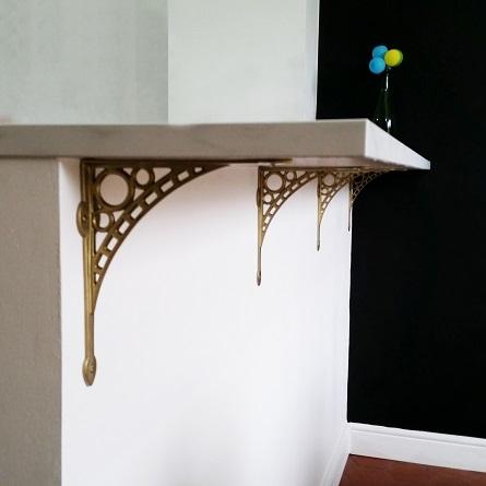 Custom gold shelf brackets