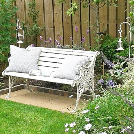 Garden bench and shepherds crook lanterns