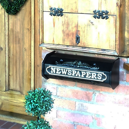 Newspaper Holder in Iron with white text
