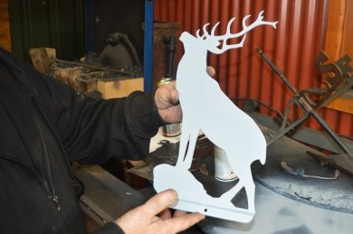 Stag weathervane being worked on