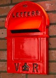 picture of red wall mounted post box in a wall