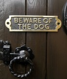 be aware of the dog signs in polished brass